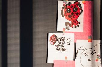 Kids drawings hanging on wall