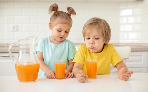 Kids drinking juice