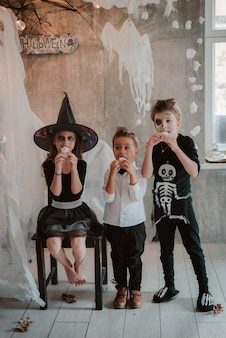 Kids eat halloween sweets costume party