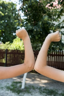 Kids greeting with their elbows