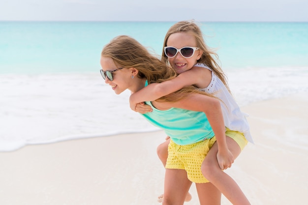 Kids have fun on the white sandy beach outdoors