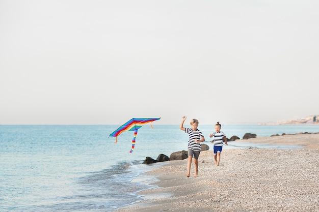 Kids having fun on the beach near the sea