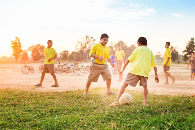 Kids having fun playing soccer football for exercise