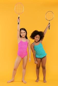 Kids having fun in a summer setting studio