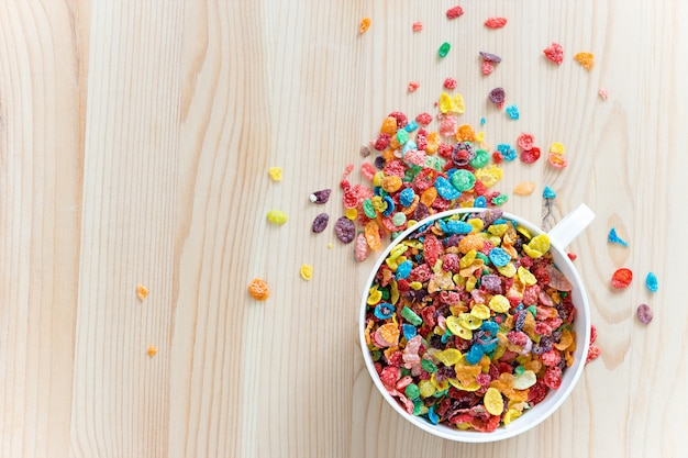Kids healthy quick breakfast. colorful rice cereal on wooden background. copy space
