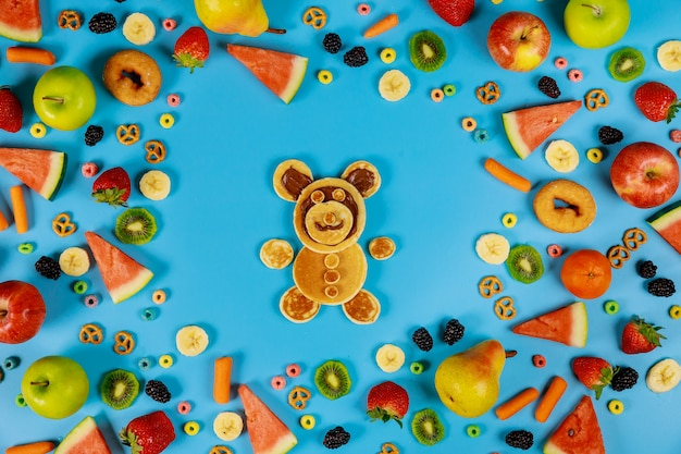 Kids healty food concept. fruits and vegetables with pancakes.