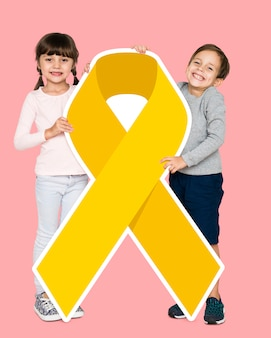 Kids holding a golden ribbon supporting childhood cancer awareness