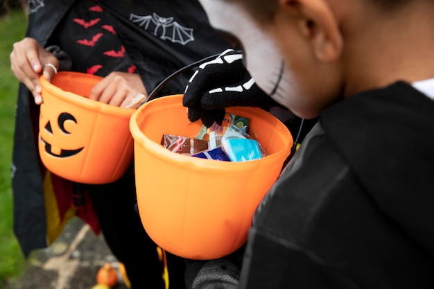Kids holding their trick or treat buckets