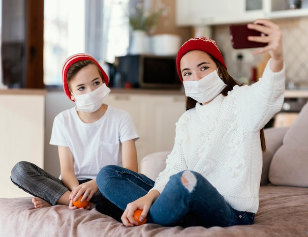 Kids at home with mask