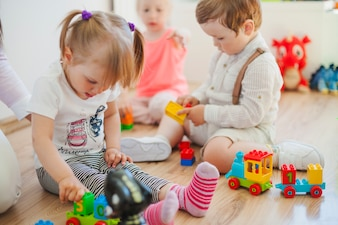 Kids in playroom on floor