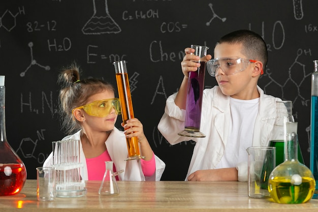 Kids in laboratory doing experiments
