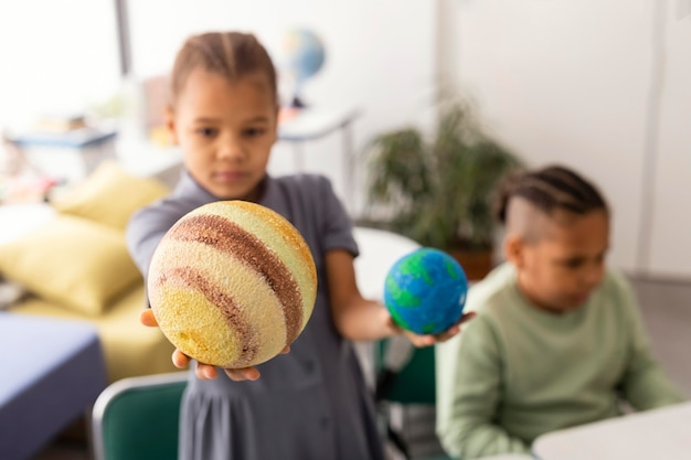 Kids learning about planets in classroom