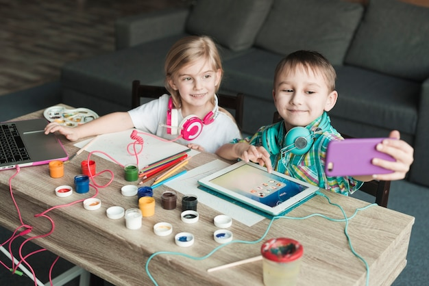 Kids painting and taking selfie