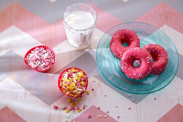 Kids party with milk pink donas and cupcake topings