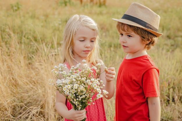 Kids play in autumn park children outdoor fun in autumn toddler kids or preschooler child in fall