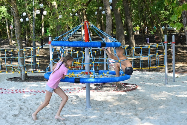 Kids on playground in summer. funny childrens vacation outdoor. friendly group of kids having fun