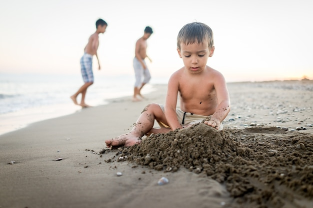 Kids playing in beach sand