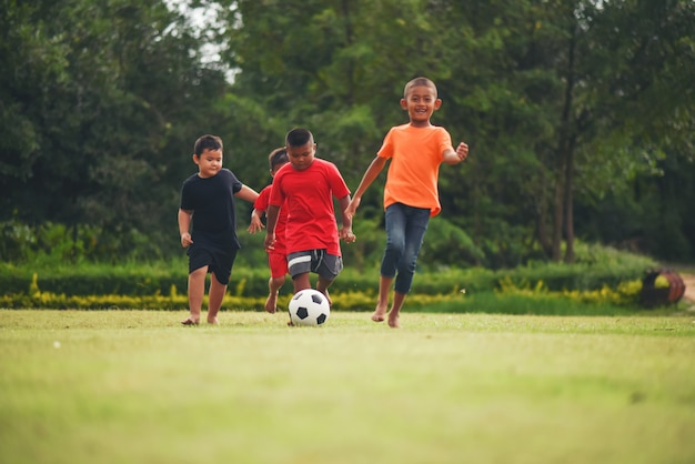 Kids playing soccer football