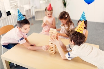 Kids playing wooden game on party