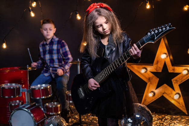 Kids pretending to be a rock band