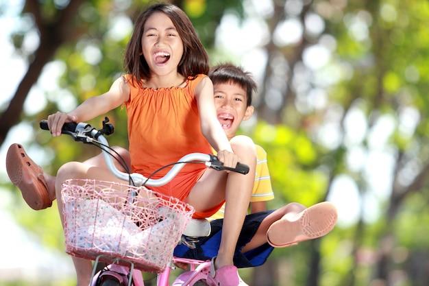 Kids riding bike together