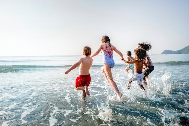 Kids running at the beach