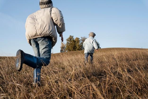 Kids running on fields full shot