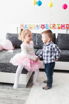 Kids shaking hands on birthday party