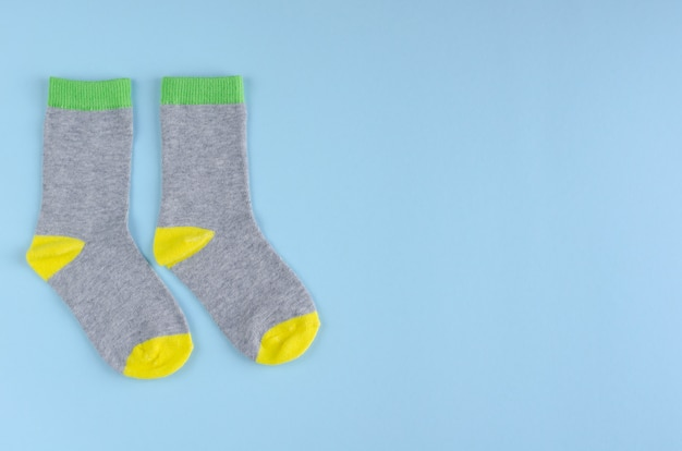 Kids socks composition on blue background. flat lay.