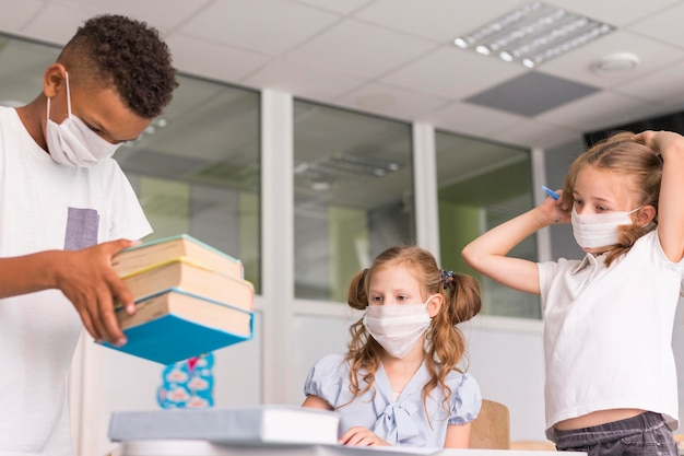 Kids spending time together in class during pandemic time