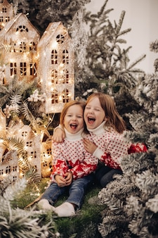 Kids standing on the upper level of christmas decoration