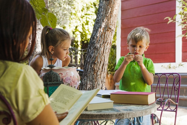 Kids studying in garden