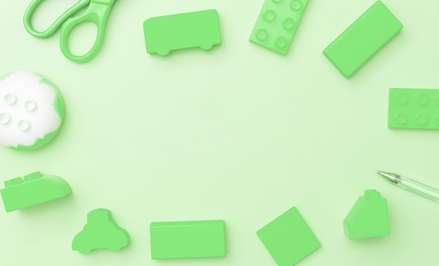 Kids toys frame on green background with toys flat lay top view with empty center
