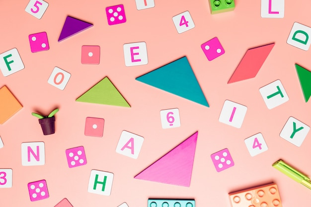 Kids toys on pink background with toys