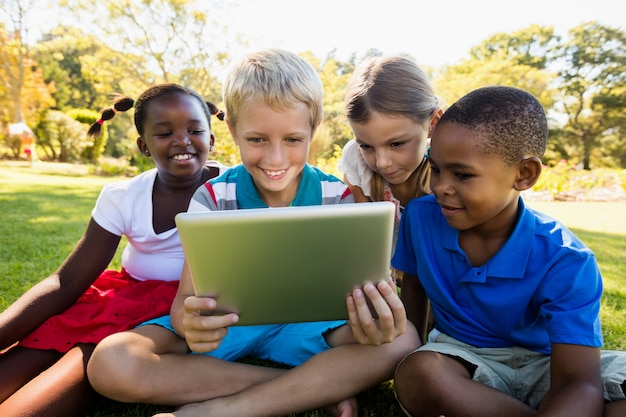 Kids using digital tablet during a sunny day