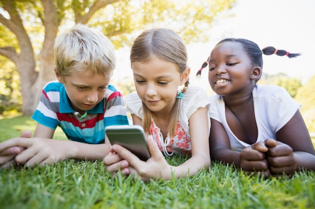 Kids using smartphone during a sunny day