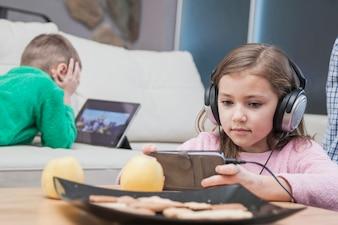 Kids using technologies in living room
