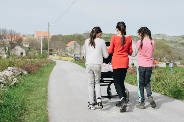 Kids walking baby in village