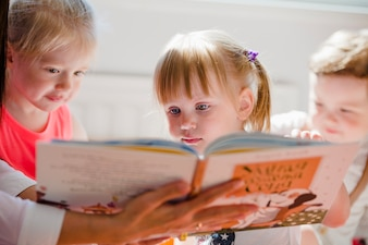 Kids watching book together