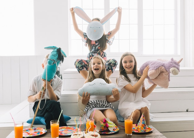Kids with toys having fun on birthday party