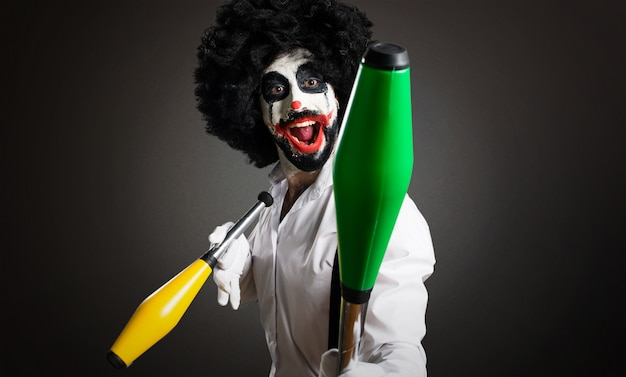 Killer clown playing on textured background