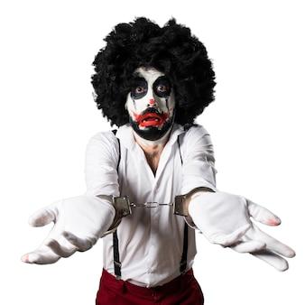 Killer clown with handcuffs