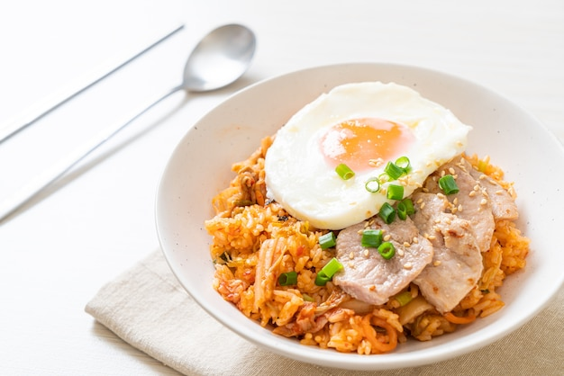 Kimchi fried rice with fried egg and pork - korean food style