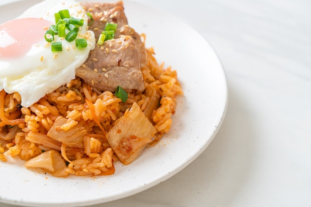 Kimchi fried rice with fried egg and pork. korean food style