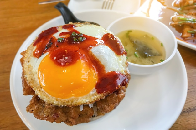 Kimchi fried rice with fried egg and pork.