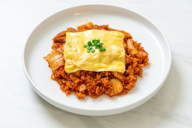 Kimchi fried rice with pork and topped cheese - asian and fusion food style