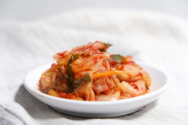 Kimchi is placed in a white plate