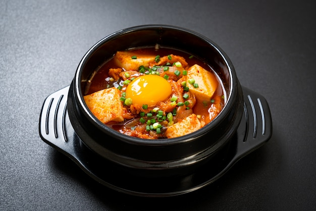 'kimchi jjigae' or kimchi soup with tofu and egg or korean kimchi stew  - korean food traditional style