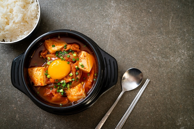 'kimchi jjigae' or kimchi soup with tofu and egg or korean kimchi stew. korean food traditional style