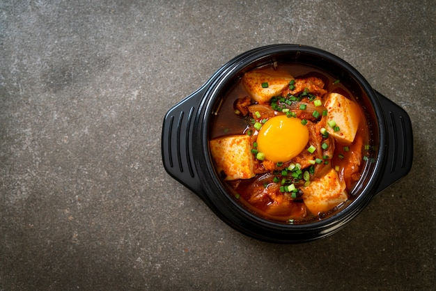 'kimchi jjigae' or kimchi soup with tofu and egg or korean kimchi stew  - korean food traditional style